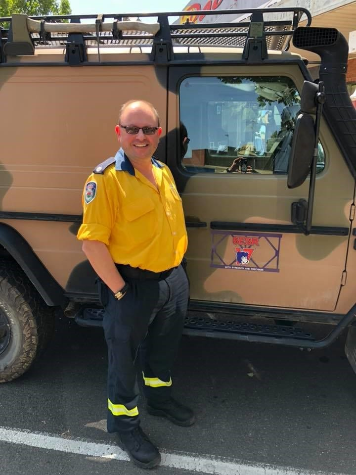 Michael Borg standing by a 17th Construction Squadron G Wagon